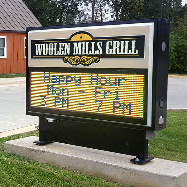 Business Sign for Woolen Mills Grill
