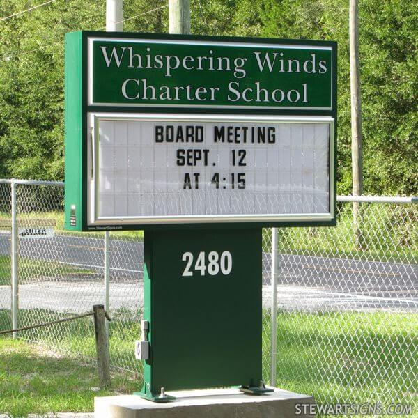 School Sign for Whispering Winds Charter School